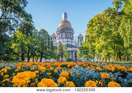 St. Isaac's Cathedral In Saint-petersburg, Flowers On The Foreground.