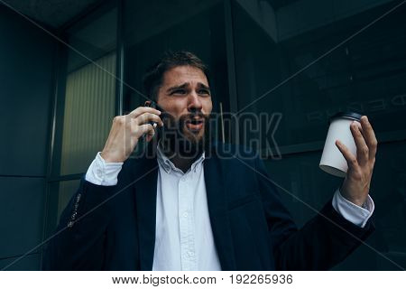 Busy man, business man, business man with a beard, business man talking on the phone.