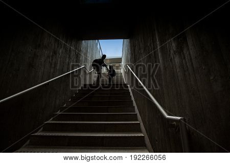 father and son climbing stairs in pedestrian subway going to the city. Concept of family in town
