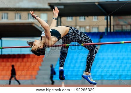 Chelyabinsk Russia - June 4 2017: woman jumper successful attempt high jump during UrFO Championship in athletics