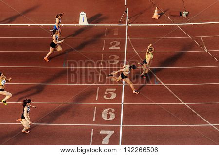 Chelyabinsk Russia - June 4 2017: finish runners group women sprint race at stadium during UrFO Championship in athletics