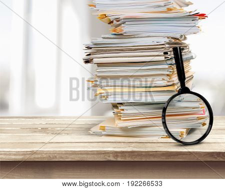Stack document magnifying glass business concepts financial form