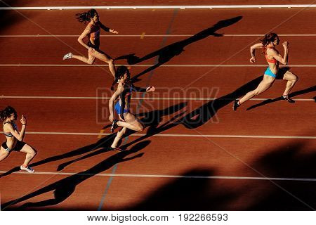 Chelyabinsk Russia - June 4 2017: shadow runners women sprint race at stadium during UrFO Championship in athletics