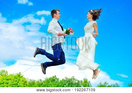 Young And Handsome Newlyweds Are Fluttering In The Air