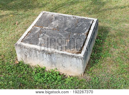 Large concretel box for keep the water valve which use control the water flow in the public park.