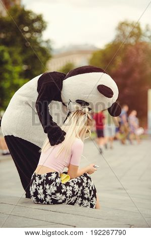 Man In A Panda Suit Comforts An Injured Woman