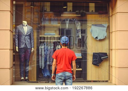 Man In Front Of Shop Window With Men's Clothes