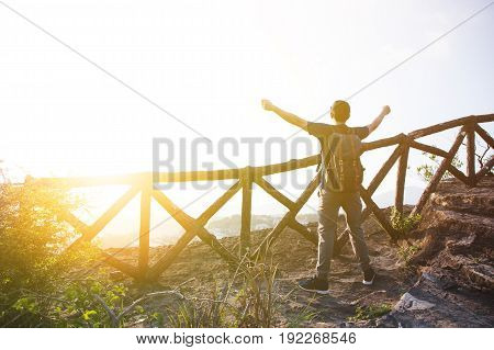 Silhouette Of Man Spreading Arms Out On The Mountain During Sunset