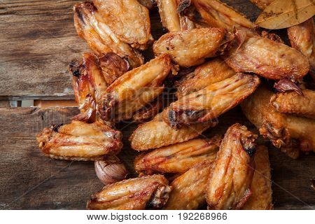 Deep fried chicken wings on basket over wooden background