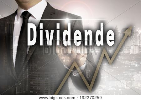 Dividende (in German Dividend) Is Shown By Businessman Concept