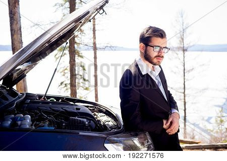 A man is under stress because his car broke