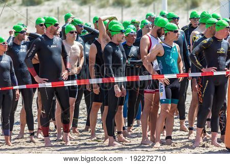 Kijkduin The Hague the Netherlands - 17 June 2017: Kijkduin cross triathlon athletes waiting at startline