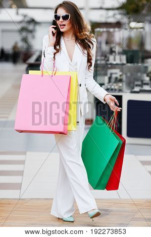 Woman Doing Shopping And Talking On Phone
