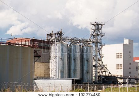 the plant of household chemicals with the metal tanks and pipes.