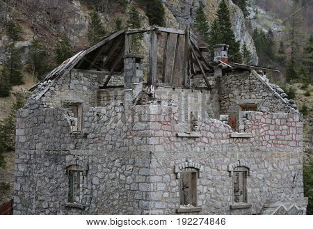 Ruined Old House Without Roof With Falling Walls In The Mountain