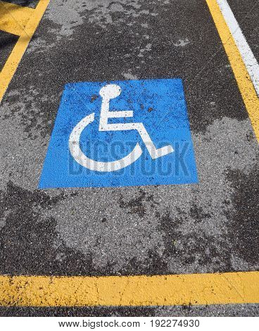 Wheelchair Symbol On A Car Reserved Parking