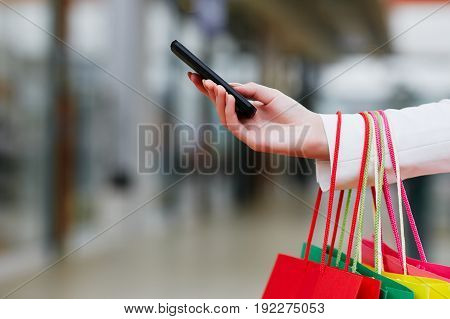 Colorful Shopping Bags And Mobile Phone