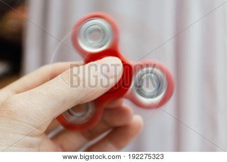 Fidget Spinner Rotating In The Hand.