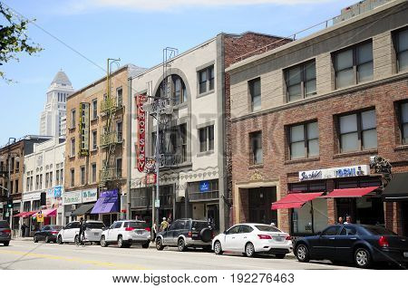 May 22 2017. Los Angeles California. Hotels restaurants and apartment buildings line a street within the Little Tokyo area in the city of Los Angeles California.