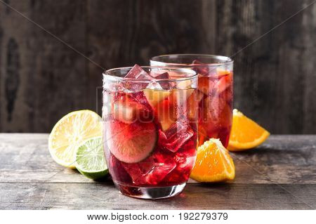 Sangria drink in glass on wooden table