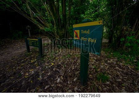 SOUTH ISLAND, NEW ZEALAND- MAY 22, 2017: Informative sign inside the forest about Abel Tasman National Park located in South Island in New Zealand.