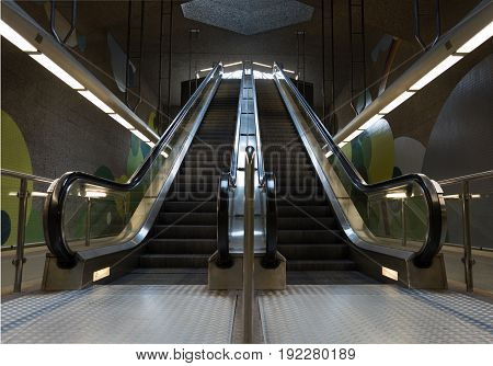 Two Moving Underground Escalator In The Subway