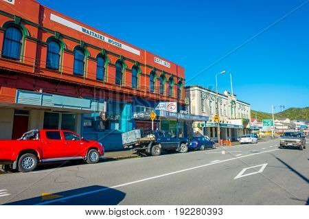 SOUTH ISLAND, NEW ZEALAND- MAY 23, 2017: Some cars parked in the street in main South Road, Greymouth, New Zealand.