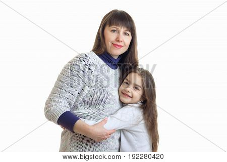 mom hugs her little daughter and smiles at the camera isolated on white background