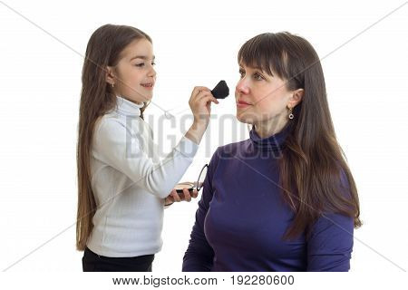 little girl makeup artist does her mom makeover isolated on white background