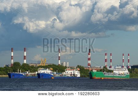 The ships are at anchor.Against the sky with beautiful cloud.