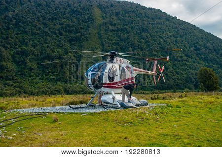 SOUTH ISLAND, NEW ZEALAND - MAY 21, 2017:Helicopter waiting for hunters in South Westland's Southern Alps, New Zealand.