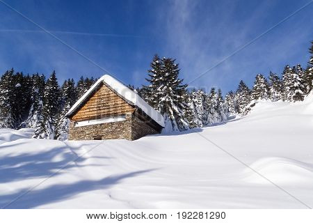 Val Blenio,Switzerland - January 6, 2014: Ascent with snowshoes at hut Gorda