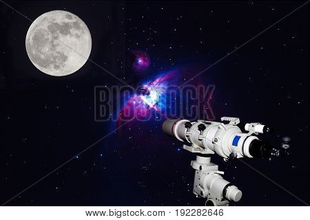 Telescope watching the Great Orion Nebula M42 NGC1976 on dark night (Deep Sky Objects ) and Full moonblurry and soft focus.