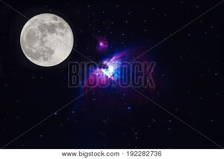Full moon and the Great Orion Nebula M42 NGC1976 on dark night (Deep Sky Objects )blurry and soft focus.