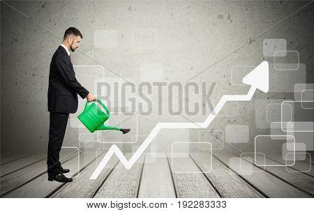 Business man arrow pouring businessman green money