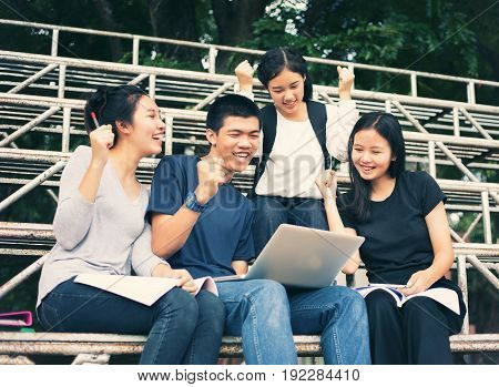 Asian Group of students Success and winning concept - happy team with raised up hands celebrating the breakthrough