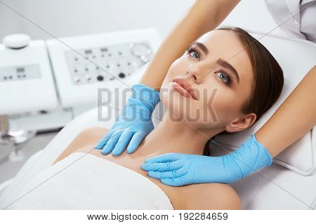 Doctor Massaging Neck Of Girl