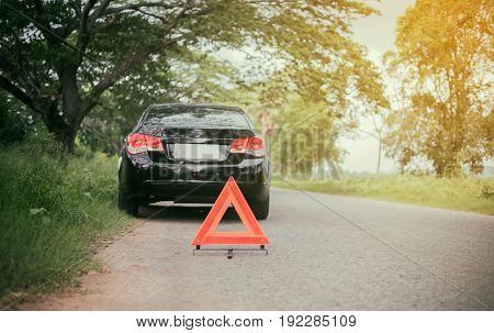 A car breakdown with Red triangle of a car on the road