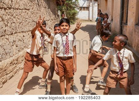 BELUR, INDIA - FEB 23, 2017: Unidentified Indian schoolkids having fun with friends in the school courtyard on February 23, 2017. Population of Karnataka state is 62000000 people