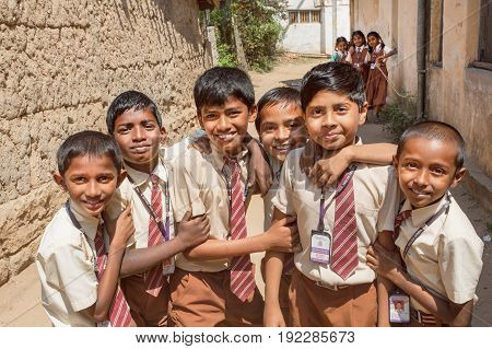 BELUR, INDIA - FEB 23, 2017: Unidentified schoolboys playing in round of friends with smily faces on February 23, 2017. Population of Karnataka state is 62000000 people