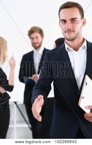 Businessman offer hand to shake as hello closeup isolated on white. Serious business friendly support service excellent prospect introduction or thanks gesture gratitude invite to participate concept