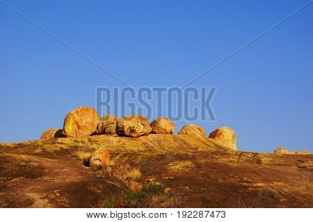 red rocks and big stones in Matopos-Rhodes National Park in Zimbabwe under an empty blues sky