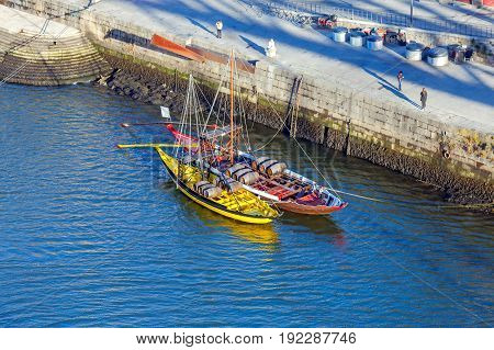 A view of the Ribeira embankment and old boats with barrels for wine. Porto. Portugal.