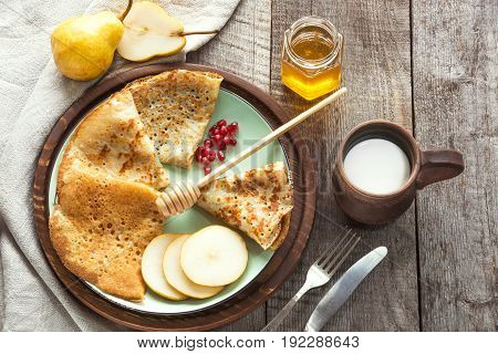 Tasty traditional russian breakfast of slapjack with honey on plate. Rustic style. Space for your.