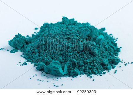 Cobalt Oxide Green Blue pigment on a white background, macro