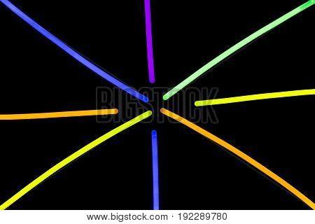 Glow sticks neon light fluorescent on back background. variation of different colored chem lights