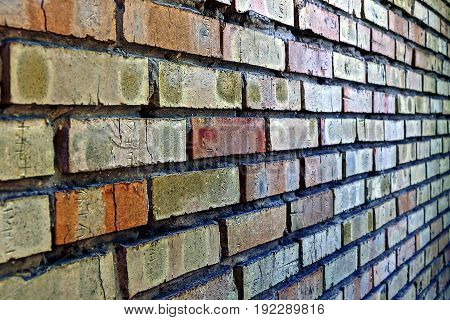 Stone texture of a brick wall of a house