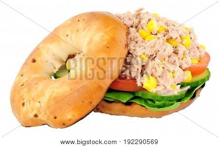 Tuna fish and sweetcorn filled bagel isolated on a white background