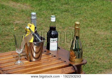 Wisley, Surrey, Uk - April 30 2017: Stylish Wooden Drinks Table, With A Bottle Of Pimms Strawberry L