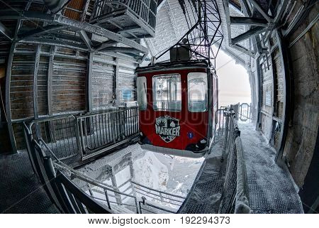 GRAINAU, GERMANY, JAN,13, 2013: Fish-eye view on red cable-way cabin at Zugspitze ski station on the highest German mountain peak. German Alps Zugspitze peak holidays vacations tours travel Zugspitze